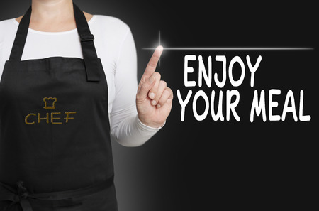 enjoy your meal touchscreen is operated by chef. Stock Photo