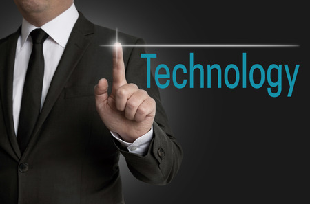touchscreen: Technology touchscreen is operated by businessman. Stock Photo