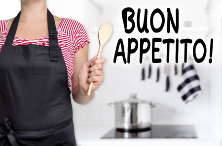 buon: buon appetito cook holding wooden spoon background.