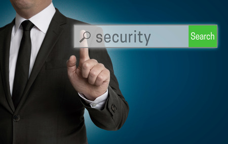 internet browser: Security internet browser is operated by businessman. Stock Photo