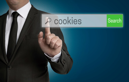 find us: Businessman searching cookies in the browser