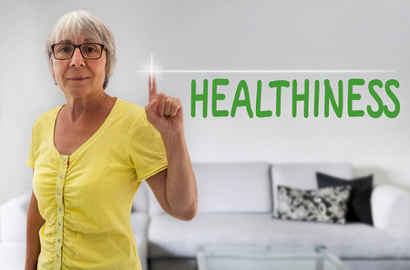 healthiness: healthiness touchscreen is shown by Senior Woman.