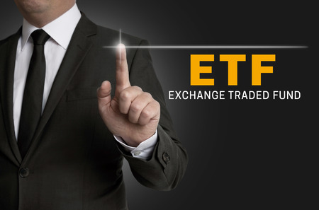 ETF touchscreen is operated by businessman.