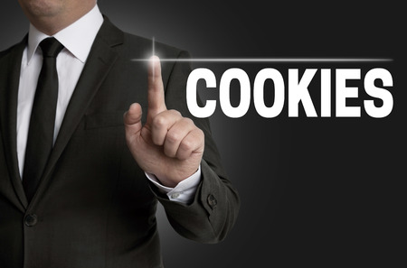 touchscreen: cookies touchscreen is operated by businessman.