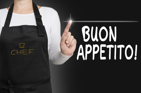 buon: buon appetito food touchscreen is operated by cook. Stock Photo