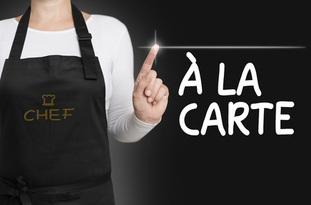 carte: a la carte food touchscreen is operated by cook.