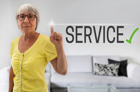 shown: servic touchscreen is shown by senior. Stock Photo