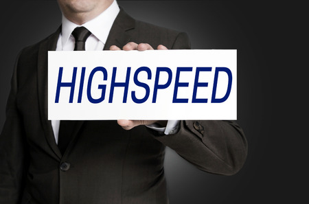 highspeed: Highspeed sign is held by businessman. Stock Photo