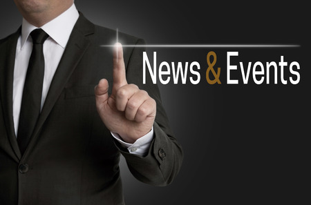 News and Events touchscreen is operated by businessman