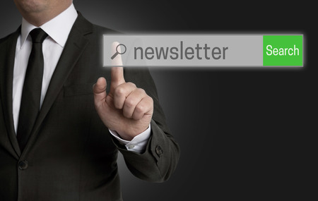 internet browser: Newsletter internet browser is operated by businessman. Stock Photo
