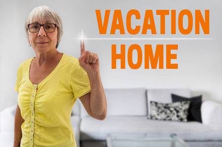 vacation home: Vacation home touchscreen is shown by senior.