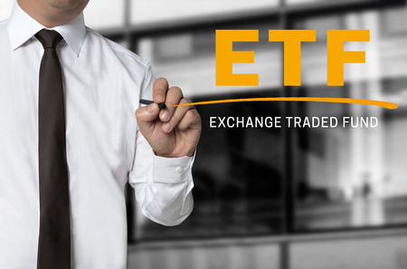 traded: ETF is written by businessman background concept.