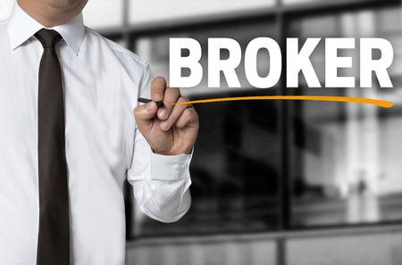 broker: broker is written by businessman background concept. Stock Photo