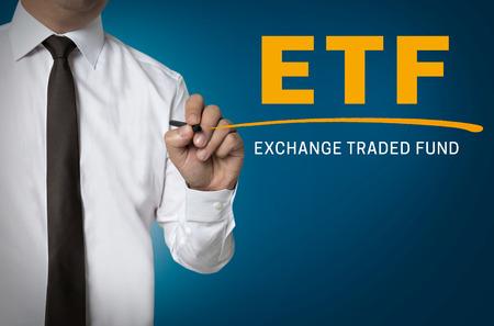 ETF is written by businessman background. Reklamní fotografie
