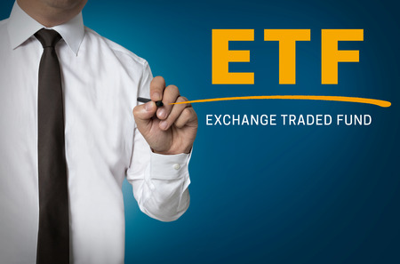 traded: ETF is written by businessman background. Stock Photo
