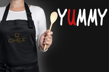 yummy: yummy cook holding wooden spoon background.