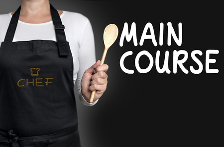 main course: Main course cook holding wooden spoon background.