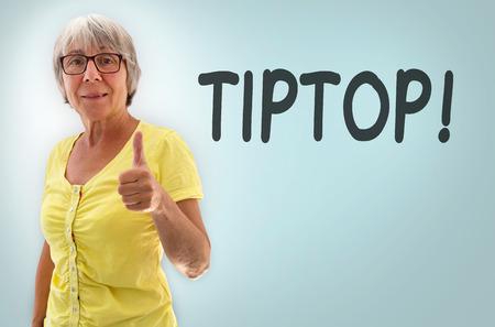 oma: Senior woman showing thumbs up tiptop concept. Stock Photo