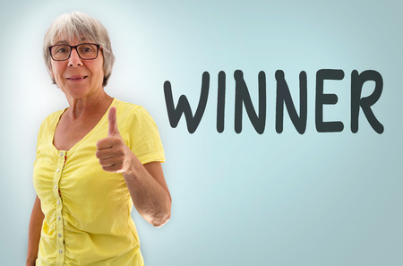oma: Senior woman showing thumbs up winner concept.