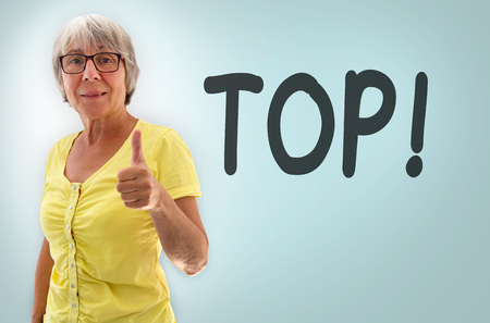 oma: Senior woman showing thumbs up Top Concept Stock Photo