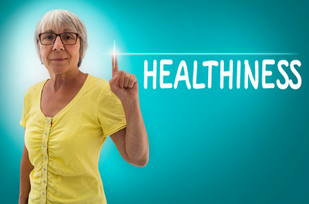 healthiness: healthiness touchscreen shown by senior concept. Stock Photo