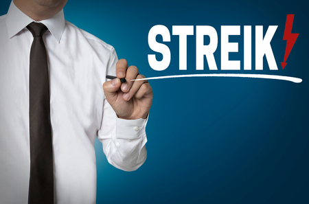 collective bargaining: Strike is written by businessman background.