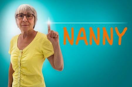 nanny: Nanny touchscreen is shown by Senior Woman concept. Stock Photo