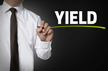yield: yield written by businessman background concept.
