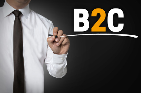 b2c: B2C is written by businessman background concept.