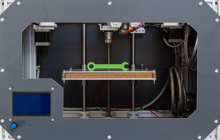 3d printer: 3d printer with bright green filament.