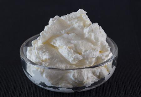 glass bowl: cream in a glass bowl Macro shot.
