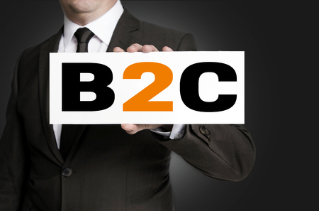 b2c: b2c shield of businessman held concept.