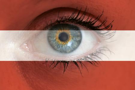 austria flag: Eye looks through Austria flag background concept macro.