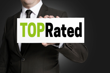 top rated: Top Rated sign is held by businessman concept.