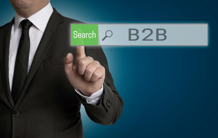 b2b: b2b browser is operated by businessman concept. Stock Photo