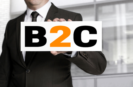 b2c: b2c sign is held by businessman concept. Stock Photo