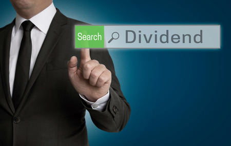 dividend: Dividend browser is operated by businessman concept.