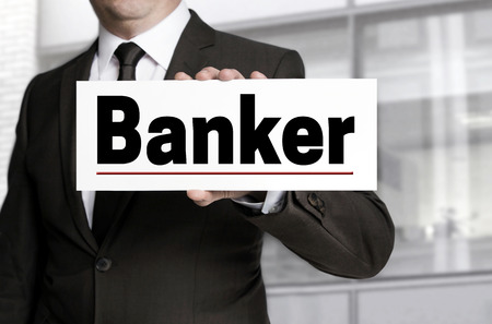 banker: Banker sign is held by businessman concept. Stock Photo