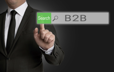 b2b: b2b browser is operated by businessman concept. Foto de archivo
