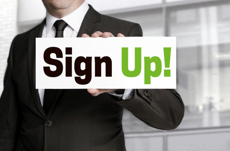 sign up plate held by businessman concept.