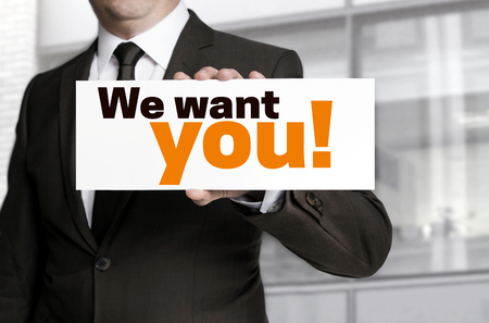 We want you; sign is held by businessman concept. Standard-Bild