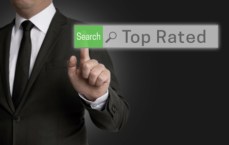 top rated: Top Rated browser is operated by businessman concept. Stock Photo
