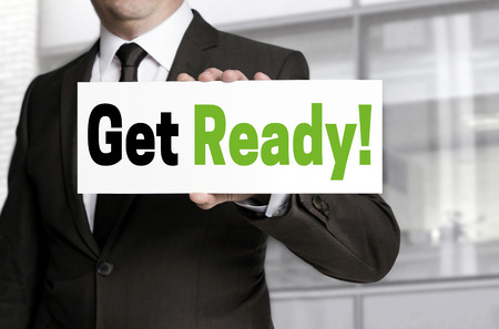get ready: Get ready sign is held by businessman concept. Stock Photo
