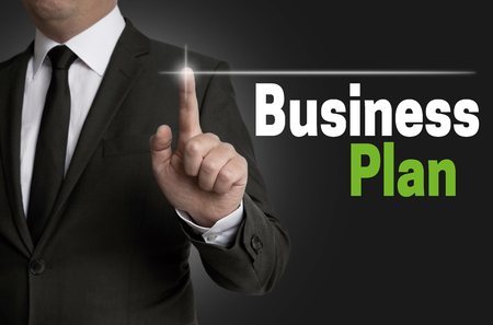 businessplan: Businessplan touchscreen is operated by businessman concept.