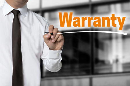 Warranty is written by businessman background concept.