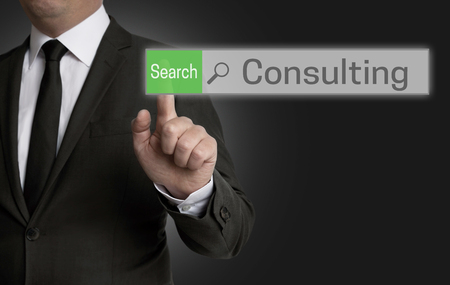 reestablishment: Consulting browser is operated by businessman concept.