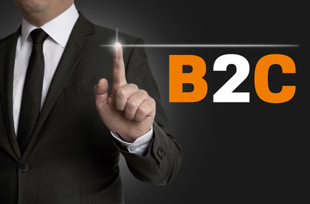b2c: b2c touchscreen is operated by businessman concept.