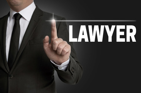 touchscreen: lawyer touchscreen is operated by businessman concept. Stock Photo