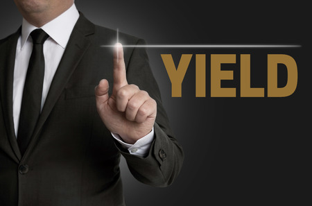 touchscreen: yield touchscreen is operated by businessman concept.