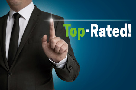 rated: top rated touchscreen is operated by businessman concept.